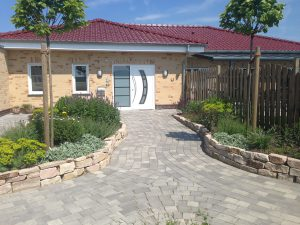 Pflasterung Hauseingang Korte Garten- und Landschaftsbau