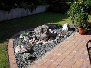 Steinbeet mit Springbrunnen Korte Garten- und Landschaftsbau